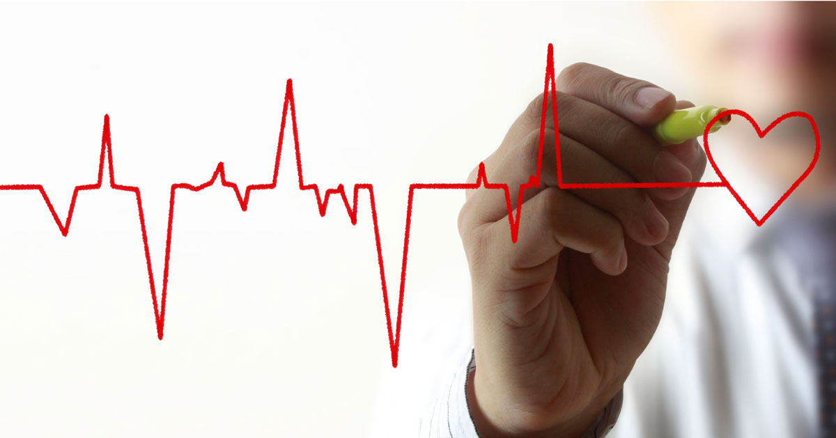 Doctor draws a heart rate line with red marker