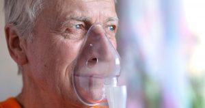 Man wearing an oxygen mask