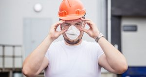 Man wearing safety construction equipment at job site