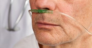 Man using oxygen nose tube