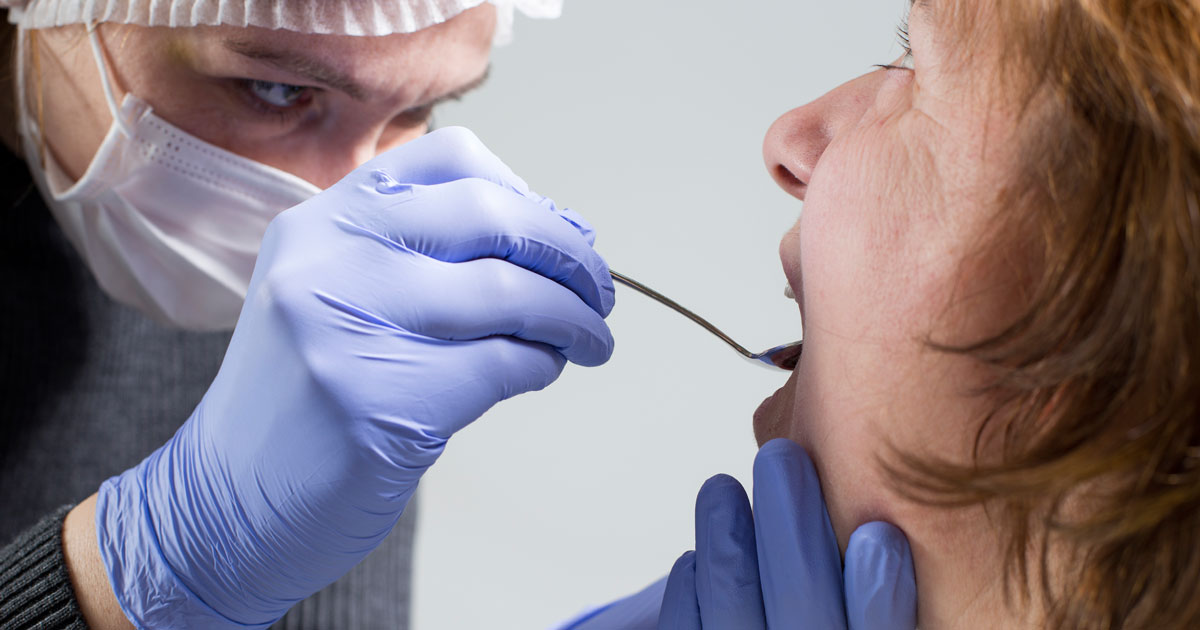 Dentist examining patient's oral health