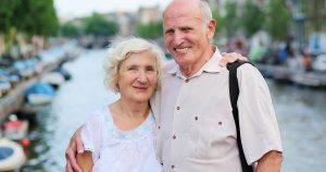 A senior couple traveling