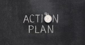 "The words ""action plan"" written down on a blackboard"