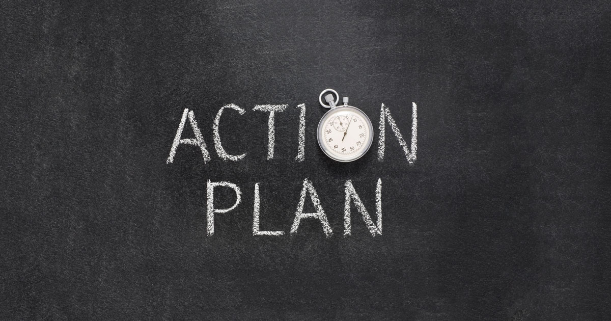 "The words ""action plan"" written down on a blackboard"