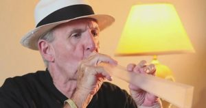 Man using a lung flute
