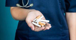 Person holding cigarettes