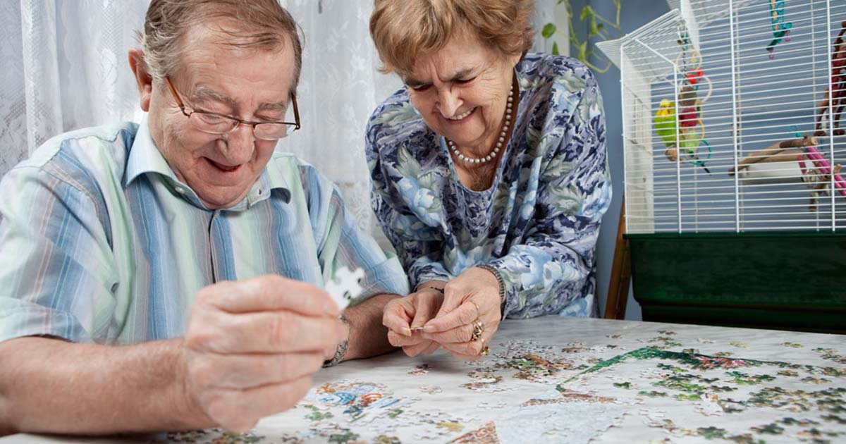 Older couple completing a puzzle together