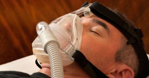 Man wearing a sleep apnea mask