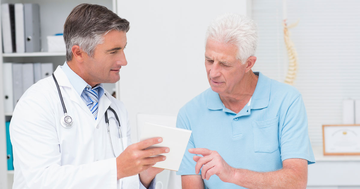 Doctor showing patient something on a piece of paper