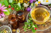 A table with flowers, tea and essential oils