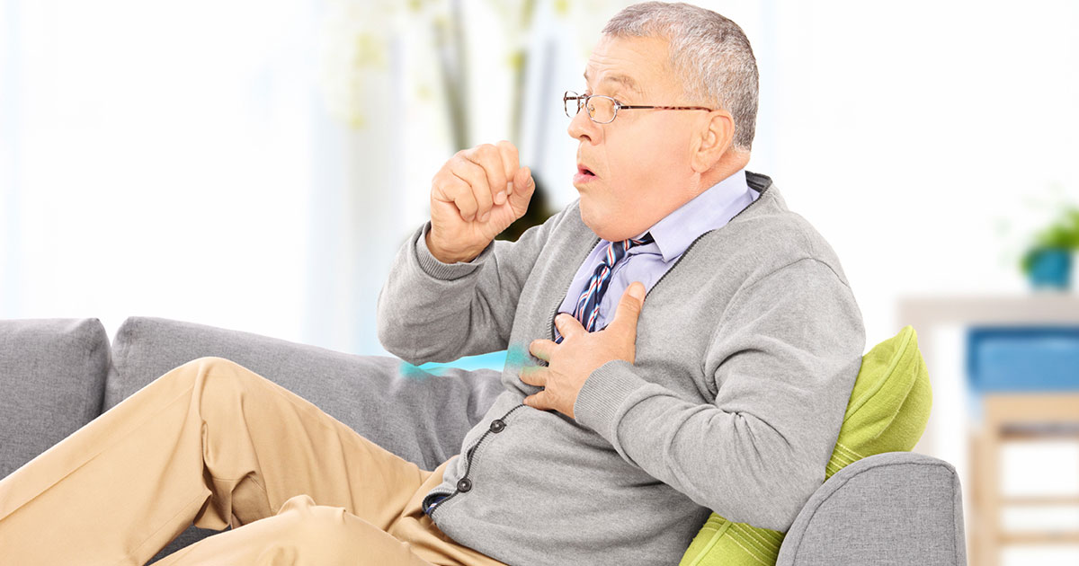 Man is having a coughing fit at home