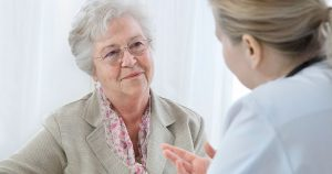 Senior female patient listens to doctor