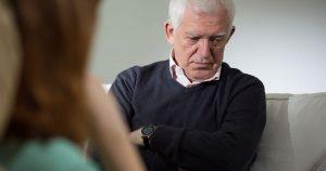 Senior man talking to a therapist