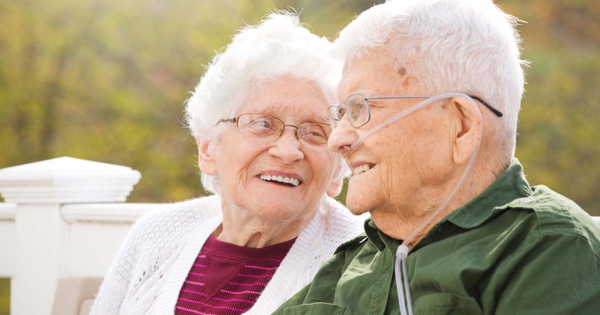 Happy senior couple enjoying conversation