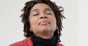 Woman is deep breathing in via her nose