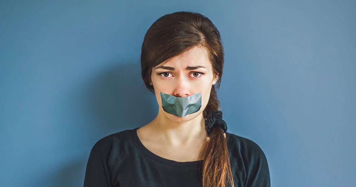 Young woman has duct tape on her mouth