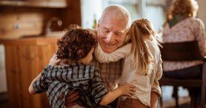 Grandparent hugging grandkids