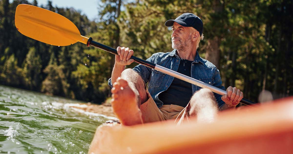 Mature man is out kayaking