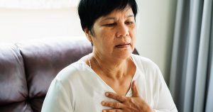 Old woman experiencing shortness of breath episode