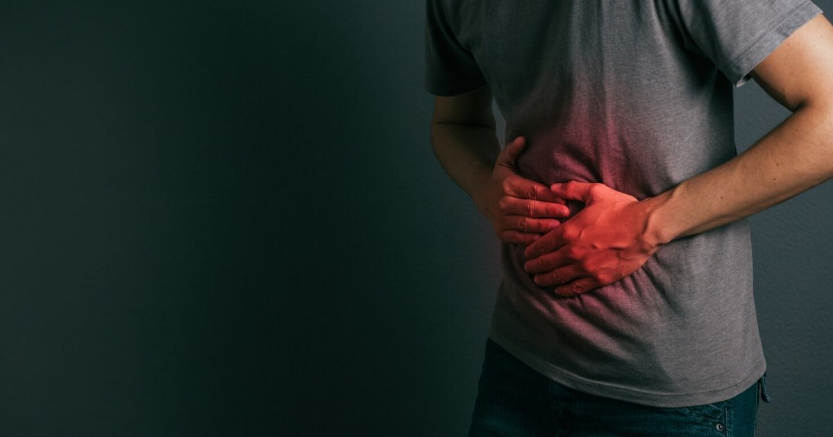 a man experiencing discomfort from bloating